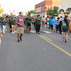 CATHY SPAULDING/Muskogee Phoenix<br /> The Pride of Muskogee Band passes the Muskogee Gay-Straight Alliance and other Muskogee High School groups after doing a U-turn on Broadway during the MHS Homecoming parade Tuesday night.