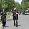 CATHY SPAULDING/Muskogee Phoenix<br /> Fort Gibson Police Officer P.J. Oosahwee, left, and Fort Gibson Police Sgt. Joe Roberts walk along 35th Street after helping Muskogee Police.