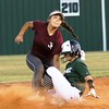 Phoenix special photo by John Hasler<br /> Muskogee's Meadow Million helps her own cause with an RBI double in the bottom of the sixth, ahead of the tag by Jenks' Ayanna Upchurch, on Monday. Million was the winning pitcher in the Lady Roughers' 4-2 win over the Lady Trojans.