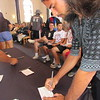 "CATHY SPAULDING/Muskogee Phoenix<br /> Bacone College student Yan Mendez of Brazil signs a ""Covenant Declaration"" card after Tuesday's convocation at Bacone Chapel. The convocation marked the official start of a new school year."