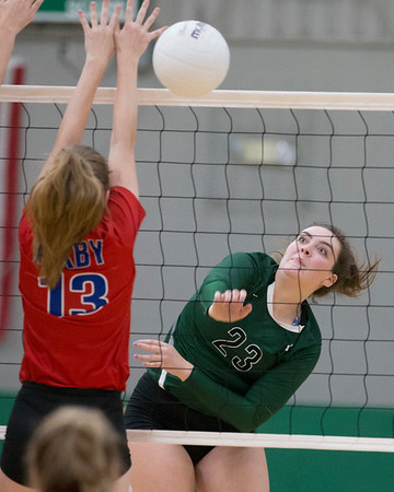 VON CASTOR/Phoenix special photo<br /> Muskogee's Carsen Lamont spikes a ball past a Bixby defender for a point Tuesday evening at Muskogee.