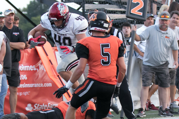 Phoenix special photo by Abigail Washington<br /> Wagoner's Steven Adair breaks away from a Coweta defender to score the first touchdown in the for Bulldogs. Wagoner came from 13 points down at halftime to beat Coweta 41-27.