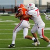Phoenix special photo by John Hasler<br /> Tahlequah's Cayden Aldridge, left, tries to escape the grasp of Fort Gibson's Tyler McFarland during Friday's game at Tahlequah. Tahlequah came from behind to beat Fort Gibson 22-18.