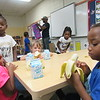 Staff photo by Cathy Spaulding<br /> Head Start pupils — from left, Orlaisha Green, Malaysia Brothers,  Serenity Smith, Brooklyn Parker and Qiam Singletary — enjoy a snack after their afternoon naps. The class meets at Cherokee Elementary School.