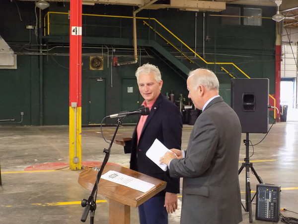 Staff photo by Mike Elswick<br /> Wagoner Mayor Albert Jones, left, is seen with Ray Yeager, president and CEO of DMI Companies, during Tuesday's ribbon-cutting ceremony recognizing the heating and air conditioning manufacturing firm's new 200,000-square-foot facility in Wagoner.