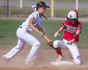 Phoenix special photo by Von Castor Fort Gibson's Hannah Thouvenel beats the tag of Checotah's CeeJay Robison for a double Tuesday afternoon at Checotah.