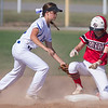 Phoenix special photo by Von Castor<br /> Fort Gibson's Hannah Thouvenel beats the tag of Checotah's CeeJay Robison for a double Tuesday afternoon at Checotah.