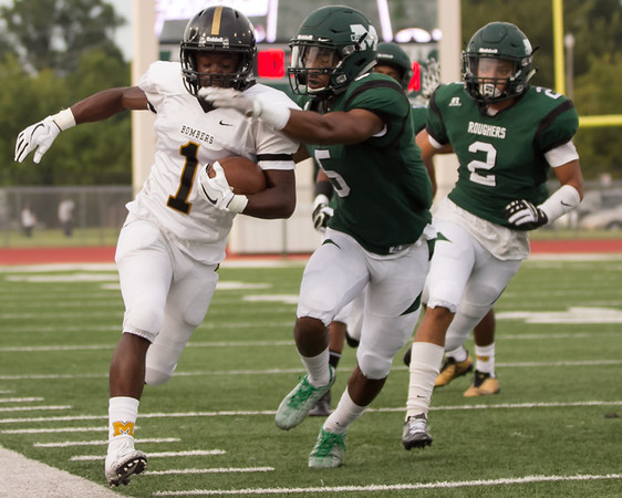 Phoenix special photo by Shane Keeter<br /> Muskogee's Devin Hillmon takes aim at a Midwest City ball carrier in action from the season-opener. Non-district slate behind them, Muskogee starts its District 6AII-2 title defense Friday with homecoming against Bartlesville.