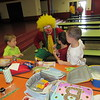 CATHY SPAULDING/Muskogee Phoenix<br /> Tin Pony, a Bedouin Shrine clown played by Robert Ishmael, visit with youngsters, from left, Koltyn Scott, Carson Moore and Harley Ward during a visit to Hilldale Elementary School cafeteria. The clowns will be part of the Shrine Circus of Thrills this weekend.