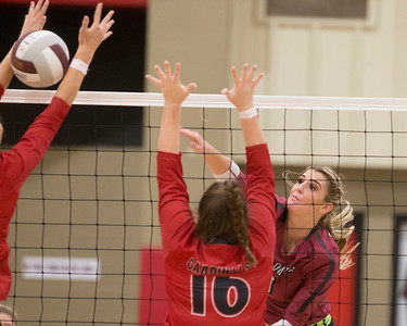 VON CASTOR/Special to the Phoenix Wagoner's Alyssa Armstrong spikes the ball through the arms of a Verdigris defender for a point Thursday evening at Wagoner.