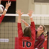 VON CASTOR/Special to the Phoenix<br /> Wagoner's Alyssa Armstrong spikes the ball through the arms of a Verdigris defender for a point Thursday evening at Wagoner.