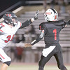 VON CASTOR/Special to the Phoenix<br /> Hilldale's Currin Finch gets to the Tulsa Central quarterback just before he releases the ball Thursday night in Tulsa.