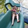 CATHY SPAULDING/Muskogee Phoenix<br /> Vanessa Campbell holds her children, Jeannessa Coleman, right, and J'Mario Coleman, as they venture down a twisty slide at Rotary Park.