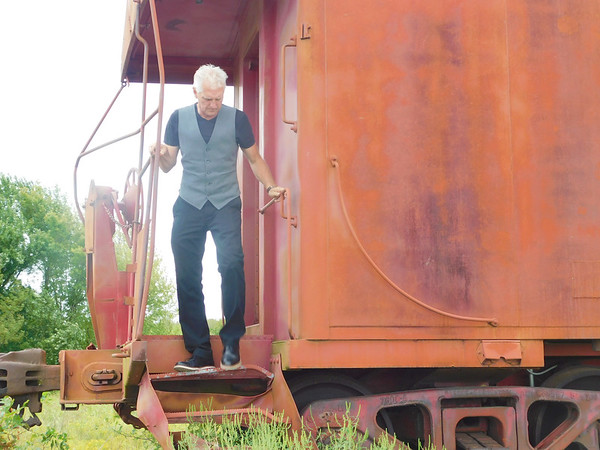 KENTON BROOKS/Muskogee Phoenix<br /> Wagoner Mayor A.J. Jones steps down from the caboose at the Wagoner Depot Friday after the city council voted unanimously to accept a bid to move the depot from its current location at U.S. 69 and Whitehorn Cove Road to the old Merrill property at Cherokee and Smith streets.