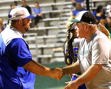 Phoenix special photo by John Hasler Roughers coach Rick Carbone shakes the hand of his predecessor, Piedmont coach Keith Coleman. Piedmont beat Muskogee 5-2 in fastpitch action Thursday. It was Coleman's first game at MHS since the 2016 slowpitch season.