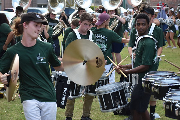 """Staff photo by Mark Hughes<br /> A percussionist playing cymbals with the Muskogee High School Band prepares to keep time with the drummers. The Pride of Muskogee and the school's cheerleaders performed to several rousing pieces of music ending with """"On Muskogee."""""""