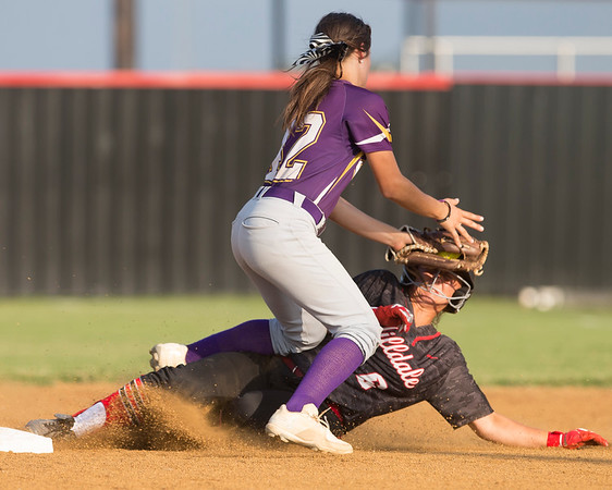 Phoenix special photo by Von Castor<br /> Hilldale's Taylor Sanchez slides into the tag of Vian's Kaycee Haning Thursday afternoon at Hilldale.