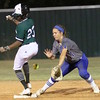 Phoenix special photo by John Hasler<br /> Muskogee's Jordan Simmons, left, beats an errant throw into second  base.