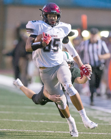 VON CASTOR/Special to the Phoenix<br /> Wagoner's Ashton Bartholomew catches a long pass and escapes the tackle of a Catoosa defender to score in the first quarter Friday night at Catoosa.