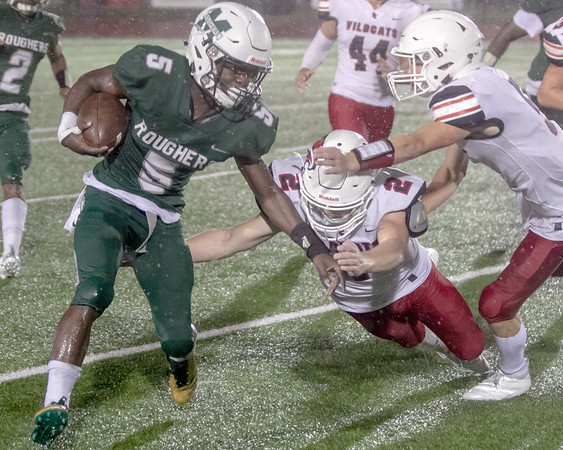 SHANE KEETER/Special to the Phoenix<br /> Muskogee's Jimmie Coleman, left, pushes off Ponca City's Eli Wohl to get around the left side during Friday's game on Creek Nation Field at Indian Bowl..The Roughers won 16-7 on Homecoming.