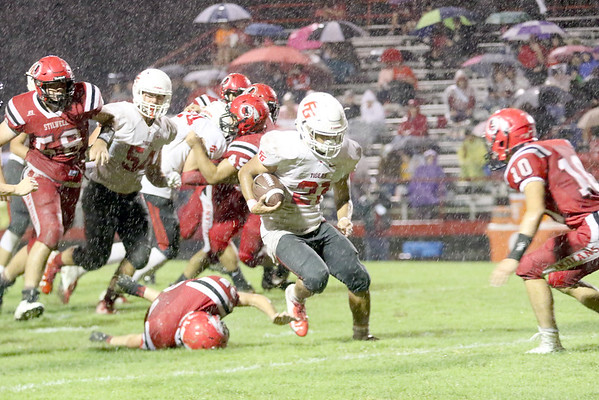JOHN HASLER/Special to the Phoenix<br /> Fort Gibson's Tavien Woodworth jumps a Stilwell defender on his way to one of his five touchdowns at the Tigers won 48-13.