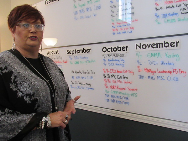 CATHY SPAULDING/Muskogee Phoenix<br /> A whiteboard crammed with events and meetings helps keep Kim Jacquez informed about Port of Muskogee activities. She is an office manager and event coordinator for the Port.