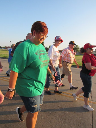 CATHY SPAULDING/Muskogee Phoenix<br /> Kim Jacquez wears a Muskogee High School Class of 1986 T-shirt while joining the Walk to Remember 9/11. Her classmate, Major Ron Milam, was killed in 9/11 attacks.