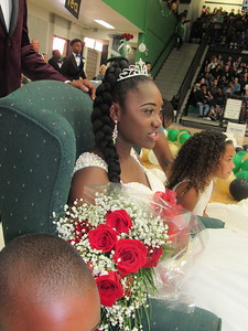 Staff photo by Cathy Spaulding Muskogee High School Homecoming Queen Imari Freeman sits by flower girl Aliyah Freeman after Friday afternoon's coronation.