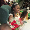 Staff photo by Cathy Spaulding<br /> Muskogee High School Homecoming Queen Imari Freeman sits by flower girl Aliyah Freeman after Friday afternoon's coronation.