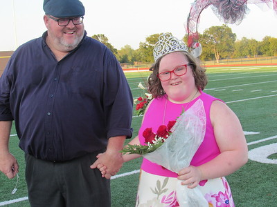 Staff photo by Cathy Spaulding Caitlin Van Zyl holds hands with her father, Francois Van Zyl shortly after he crowned her Fort Gibson All School Queen during a Friday evening ceremony. She is the third Special Olympics Queen to receive the honor.
