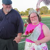 Staff photo by Cathy Spaulding<br /> Caitlin Van Zyl holds hands with her father, Francois Van Zyl shortly after he crowned her Fort Gibson All School Queen during a Friday evening ceremony. She is the third Special Olympics Queen to receive the honor.