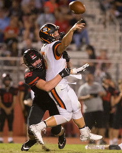 Phoenix special photo by Von Castor Hilldale's Josh Kramer forces an arrant pass by Sallisaw's Caden Bailey which is intercepted for a pick six in the third quarter Friday night at Hilldale.