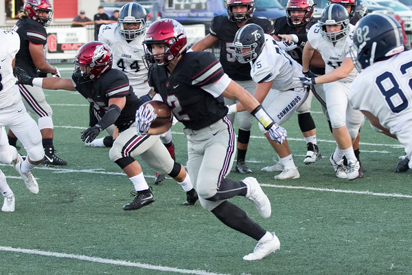 Phoenix special photo by Shane Keeter<br /> Wagoner's Schyler Adair busts through the Cascia Hall defense for a 72-yard touchdown run on third play of the game. The Bulldogs extended their winning streak to 41 staraight with a 34-7 win on Friday.