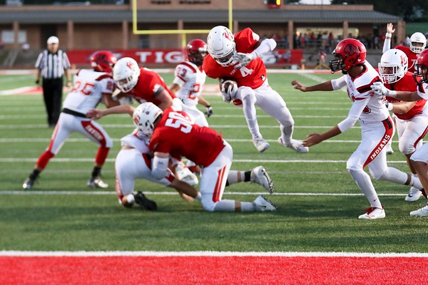 Phoenix special photo by John Hasler<br /> Fort Gibson's Rusty Rudd leaps through the Stilwell defense for a touchdown, during the Tigers' 63-6 win on Friday at Leo Donahue Tiger Stadium.