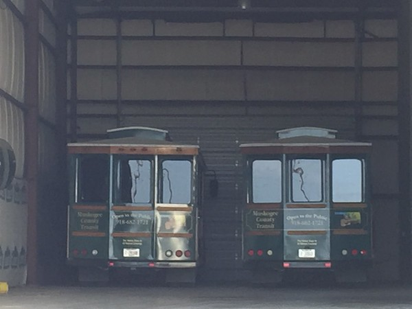 Staff photo by Mike Elswick<br /> A pair of Muskogee County Transit Authority trolleys sat idle in the garage at the authority after questions of how the trolleys were being used arose in conjunction with federal funding for the authority, officials said. Local tourism representatives said the vehicles have been popular with visitors.