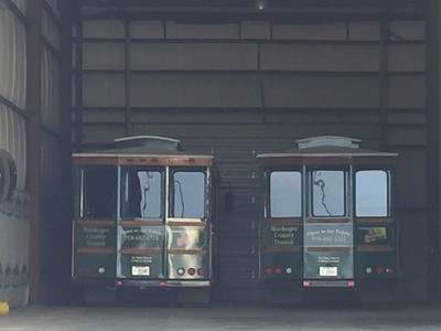 Staff photo by Mike Elswick A pair of Muskogee County Transit Authority trolleys sat idle in the garage at the authority after questions of how the trolleys were being used arose in conjunction with federal funding for the authority, officials said. Local tourism representatives said the vehicles have been popular with visitors.