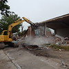 KENTON BROOKS/Muskogee Phoenix<br /> Michael Berry of Dirt Work Done Right works an excavator Monday to demolish the old day care center on South York Street. The building also was used as a bank and a plumbers union hall. Berry said a Chicken Express restaurant will be put up in the location. The project began last Friday and will take seven to eight days from demolishing to cleaning up the property, Berry said.