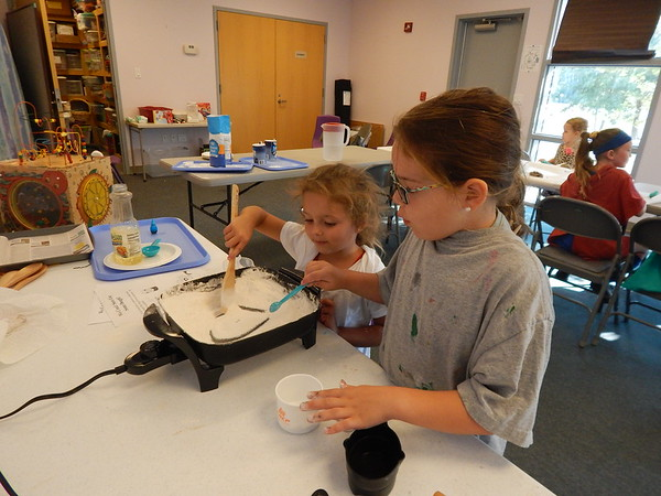 KENTON BROOKS/Muskogee Phoenix<br /> Kayleigh Smith, right, and McKinley McCormick of Fort Gibson team up to make play dough as part of the weekly STEAM educational program at the Q.B. Boydstun Public Library.