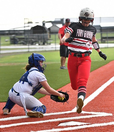 JIM WEBER/Phoenix Special Photo<br /> Fort Gibson's Hannah Thouvenel avoids tag applied by Checotah's Sabetha Sands in the first inning Tuesday.