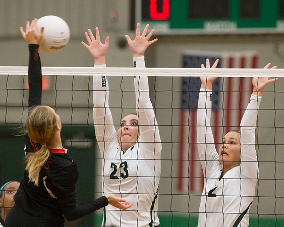 Phoenix special photo by Von Castor Muskogee's Wren Seabolt , right, and Carsen Lamont look to block a shot from an East Central attack on Monday evening at Muskogee.