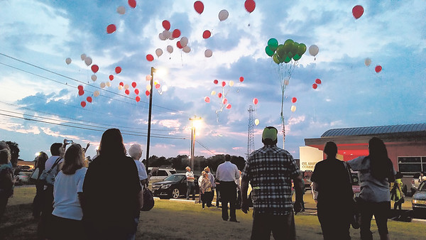 Staff photo by Wendy Burton Family members and friends of people who have been murdered release balloons in their honor as part of the National Day of Remembrance of Murder Victims. The event took place Monday at the Dr. Martin Luther King Jr. Community Center.