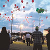 Staff photo by Wendy Burton<br /> Family members and friends of people who have been murdered release balloons in their honor as part of the National Day of Remembrance of Murder Victims. The event took place Monday at the Dr. Martin Luther King Jr. Community Center.