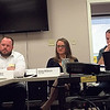 Staff photo by Mike Elswick<br /> Ashley Wilbourn, center, director of tourism for the Greater Muskogee Area Chamber of Commerce, listens Wednesday to comments being made during a tourism committee meeting. Wilbourn is flanked by Justin O'Neal, marketing coordinator, left, and Jim Blair, tourism chairman, right.