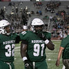 SHANE KEETER/Special to the Phoenix<br /> Muskogee's Devion Williams, right, celebrates with Nikaury Ruffin after earning a sack during a game this season.