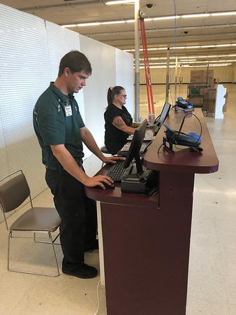 CHESLEY OXENDINE/Muskogee Phoenix<br /> U-Haul General Manager Matt Hunter, left, and new employee Julie Grandstaff check their workstations while the new store is renovated around them.