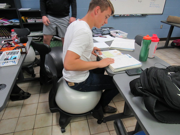 Staff photo by Cathy Spaulding<br /> Indian Capital Technology Center student Caleb Coffelt, a Haskell senior, uses a therapy ball seat while studying sports medicine. He said the seat requires your back to be straight.