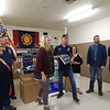KENTON BROOKS/Muskogee Phoenix<br /> Woodmen Life, an insurance company, donated 100 American flags to American Legion Post 20 in Fort Gibson on Wednesday night. Billie Floyd, the community outreach manager for the company, presents one of the flags to Post Commander Tim Smith. Others at the ceremony, from left, included Sherry Kimbale of Woodmen Life, legionnaire Jim Schagunn, Floyd, Smith, Trina Burdge and Dustin Donnell of Woodmen Life and the post's financial officer, J.D. McLaughlin.