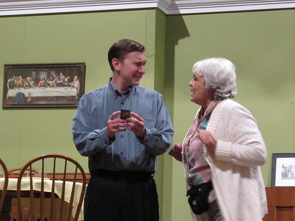 "CATHY SPAULDING/Muskogee Phoenix<br /> Nick (Braden Thomson), left, has news to tell his grandmother, Emma (Terral Graybill) and other grandparents assembled for Sunday dinner. See what the news is in the Muskogee Little Theatre production ""Over the River and Through the Woods."""