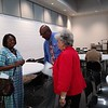 WENDY BURTON/Special to the Phoenix<br /> Chair of the Oklahoma Democratic Party Alicia Andrews, left, greets Muskogee County Democrats Chair Cedric Johnson and Vice-Chair Judy Moore, right, before the Muskogee County organization's meeting Thursday evening.