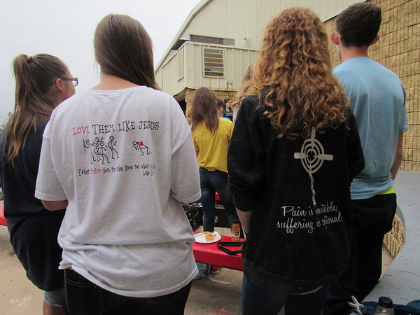 Staff photo by Cathy Spaulding<br /> Students wear Christian-themed T-shirts during Hilldale's See You at the Pole gathering Wednesday.